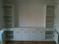 A modern version of a dresser with everything concealed away