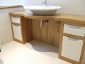 solid-oak-unit-with-inset-ivory-doors-with-chrome-handles